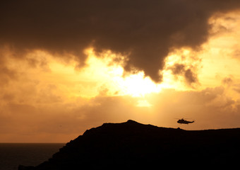 RAf Sea King flying into the sunset