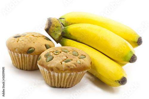 Fototapete bunch of bananas and raisin cup cake