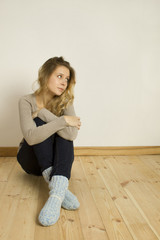 Young woman sitting on the floor at home