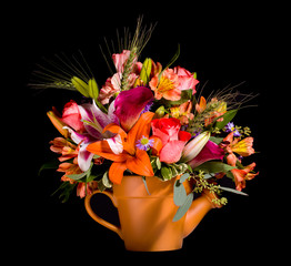 Bouquet of flowers in watering can