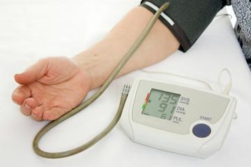 Hand an elderly woman with a sphygmomanometer