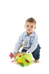 Sweet toddler with soft toy
