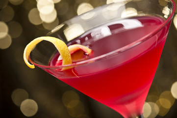 Cosmopolitan cocktail with lemon garnish