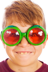 Funny looking kid with bug eyed glasses