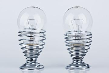 Light bulbs in a modern metal egg cup