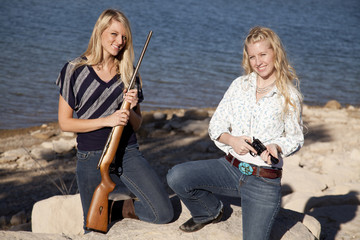 girls with guns by water