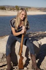 woman lake rifle smile