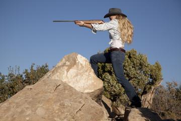 woman pointing gun rocks