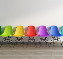 Interior with vintage plastic colored chairs on wood floor