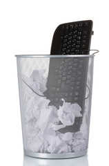 Old PC keyboard and paper in metal trash bin isolated on white