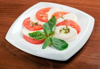 Arrangement of mozzarella and tomatoes