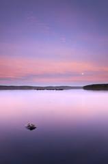 Moon rising over swedish lake
