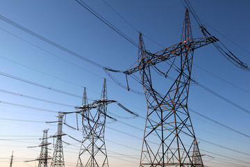 high voltage electrical towers in line