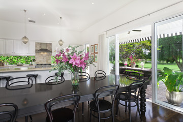 Dining area and kitchen overlooking a golf course