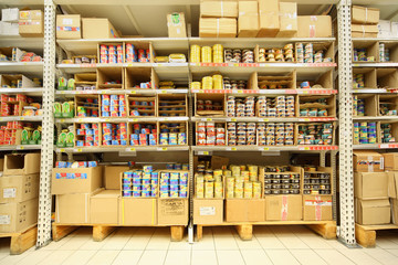 Shelves with canned fish in shop