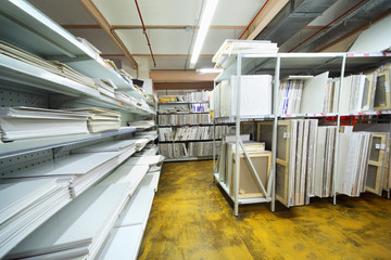 on shelves many canvases on stretchers for artists