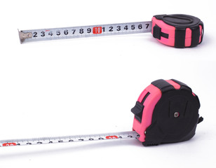 Set of two tape measure on white background