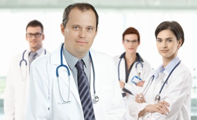 Mid-adult doctor leading medical team