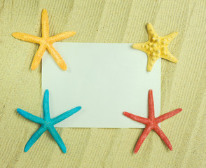 starfish and shells with frame on the beach, vacation memories .