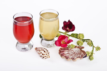 fresh juice on glass and flowers