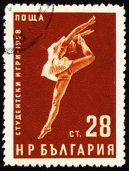Dancing young woman on post stamp
