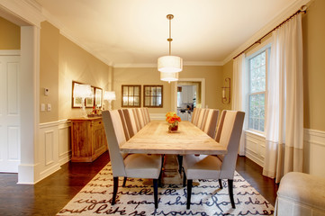 Natural design home dining room with large wood table.