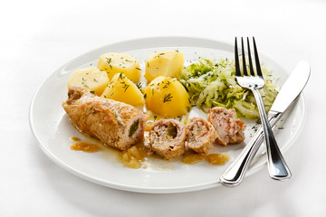 Roasted stuffed pork chop and vegetables