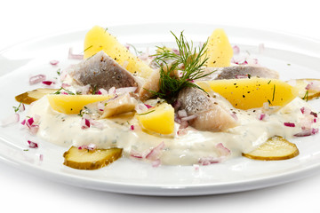 Marinated herring fillets with cream and vegetables