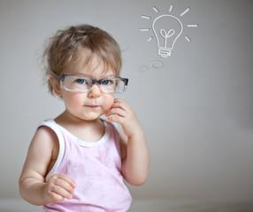 Baby having an idea