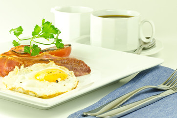 egg, bacon and tomato breakfast with coffee