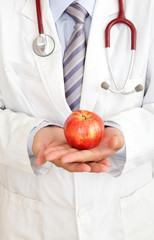 doctor holding a apple