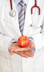 doctor's hand with a apple