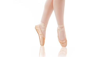 detail of ballet dancer's feet on white background