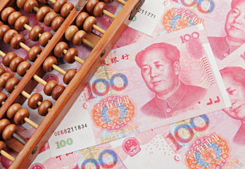 abacus and china money banknote