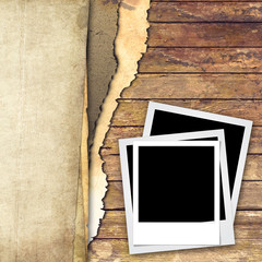 Ripped paper and photo frame on wood background