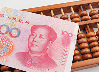 abacus and china dollar banknote