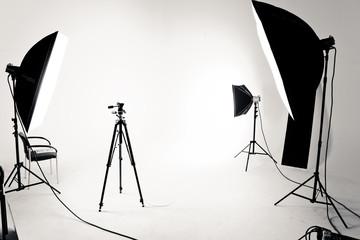 Photo production studio set with flashlights and tripod