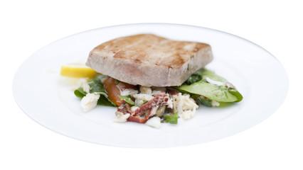 Grilled marinated Ahi tuna salad with crab, baby spinach, dressi