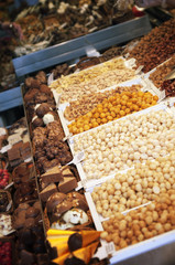 Stall with chocolates candy at Boqueria Market in Barcelona.