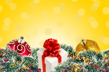 gift box and Christmas tree ornaments and Christmas tree branche