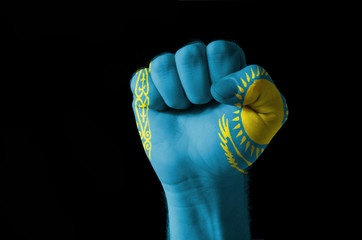 Fist painted in colors of kazakstan flag