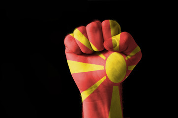Fist painted in colors of macedonia flag