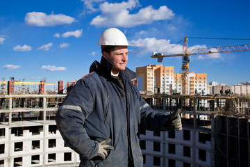 Construction foreman pointing OK hand gesture