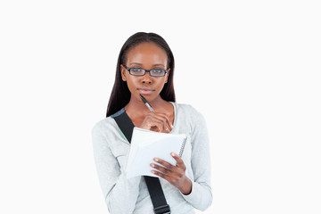 Young woman with glasses and notepad