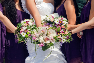 bride and  maids of honor  with bouquets