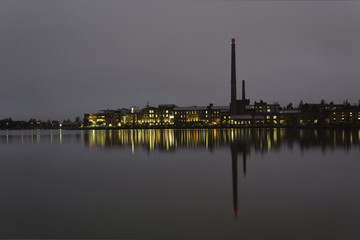 Industrial view by sea at night