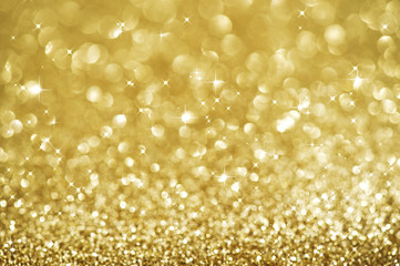 Christmas Glittering background. Holiday Gold abstract texture