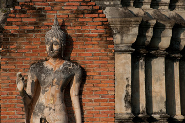 Ancient image Buddha statue in Sukhothai historical park .