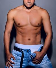 Tanned muscular male torso