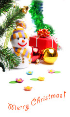 Snowman on the background of Christmas decorations